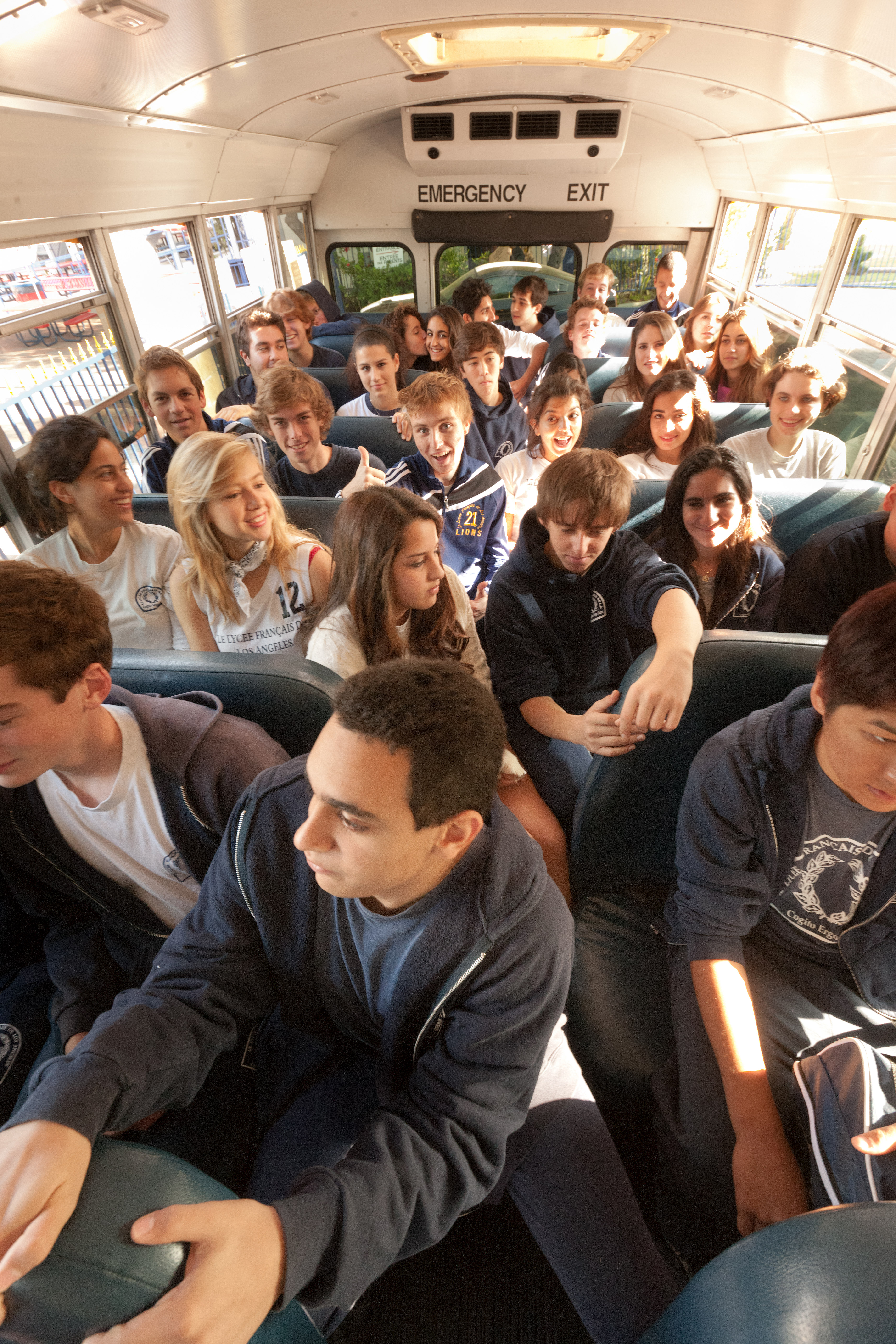 High school students inside a school bus going on a trip